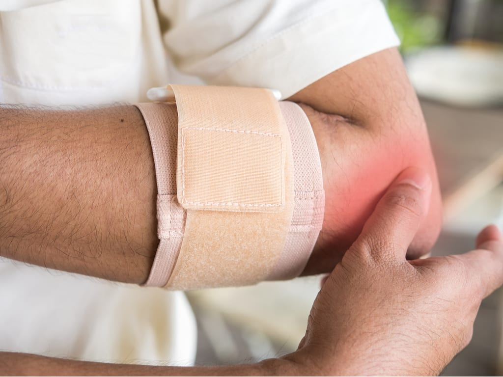 a man with tennis elbow pain