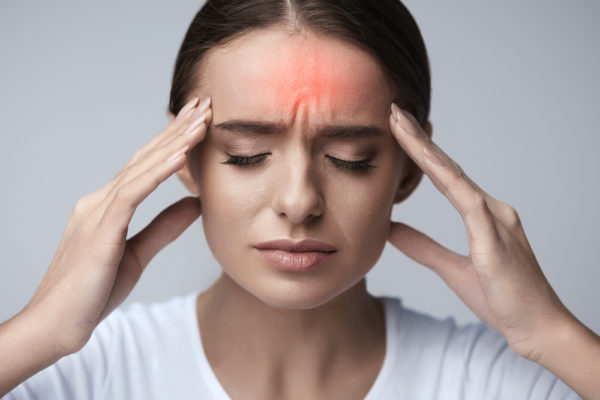 a woman suffering from headaches