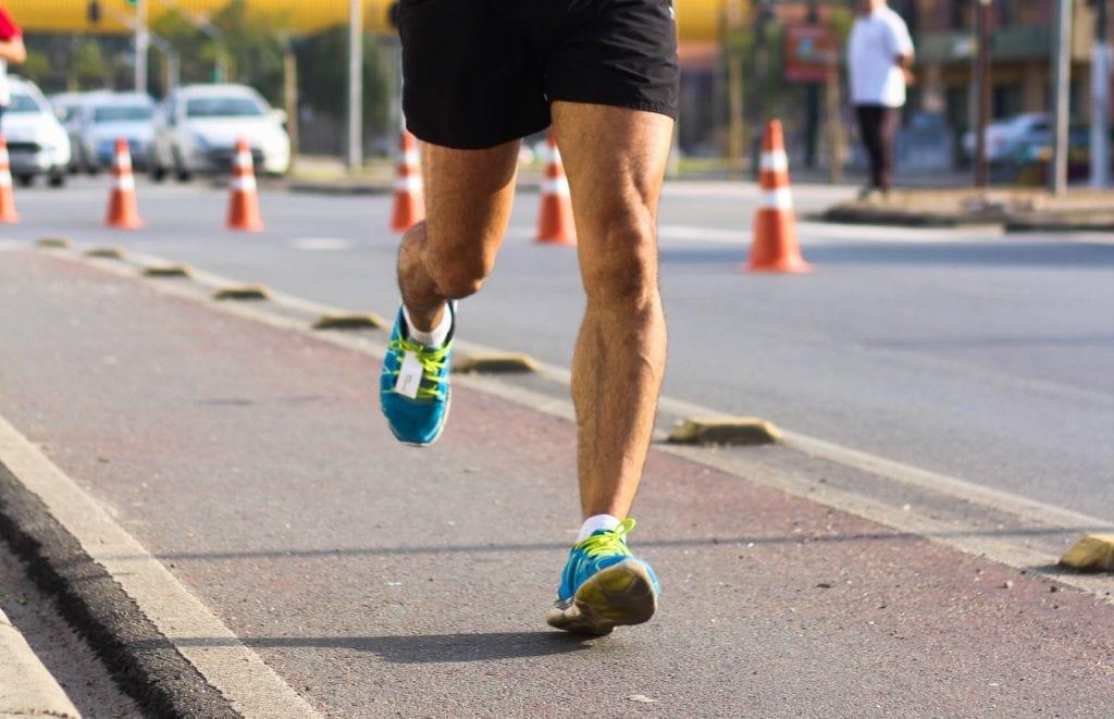 a man running on the sidewalk